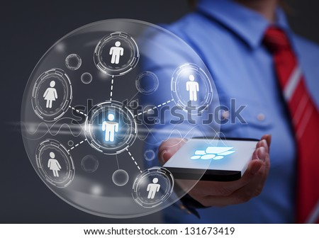 Business woman accessing global social network with smartphone - stock photo