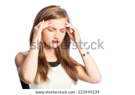 Business woman acting a headache pressing her forehead with fingers