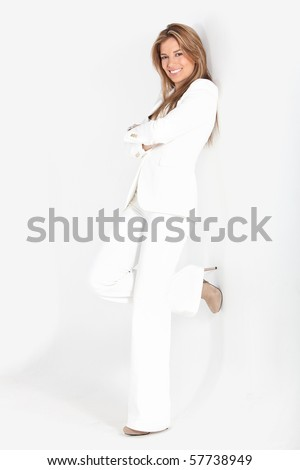 Business woman against a wall and smiling - isolated - stock photo