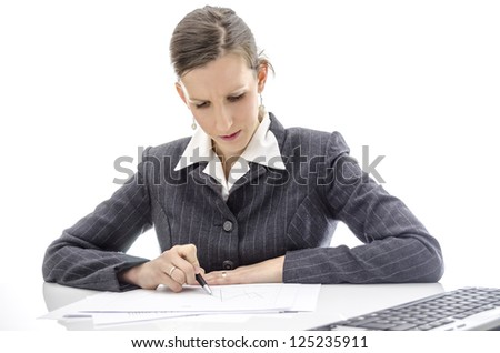 Business woman analyzing documents at office desk. Isolated over white background.