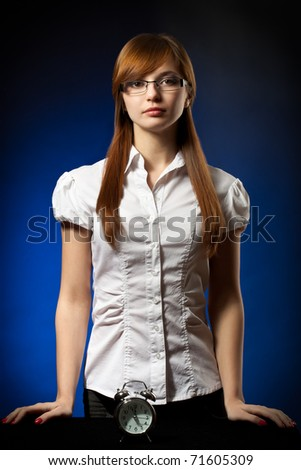 business woman and alarm clock, deadline concept - stock photo