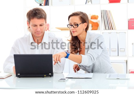 Business woman and businessman working at the office. - stock photo