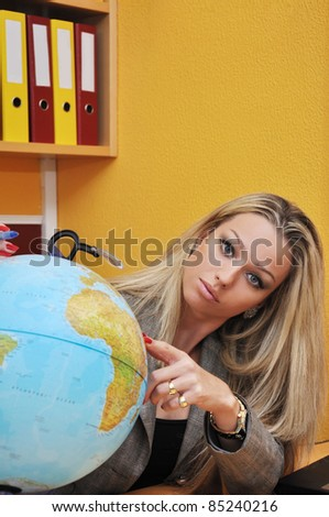 Business woman and globe