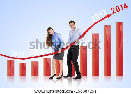 Business woman and man are trying to increase market statistics. - stock photo