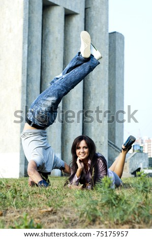 business woman and street dancer - stock photo
