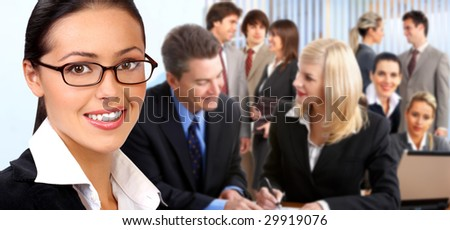 Business woman and young smiling business people.