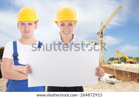 business woman architect and man builder in yellow helmet at construction site - stock photo