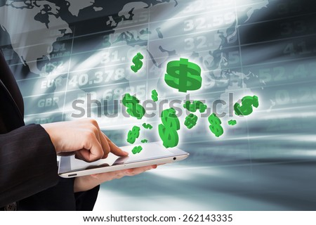 Business woman are checking exchange rates by using digital tablet - stock photo