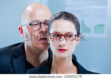 business woman asking herself why and when did she accept to be pestered like that - stock photo
