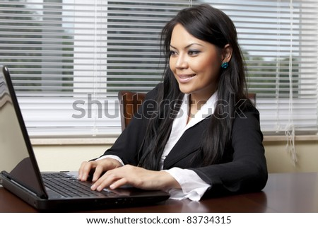 Business woman at desk - stock photo