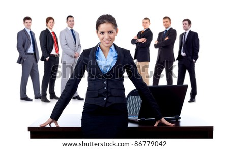 business woman at her desk and her team behind her, on white background - stock photo