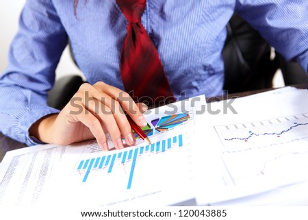 Business woman at office sitting at table and working