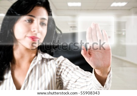 Business woman at office touching digital screens - stock photo