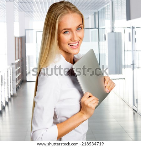 Business woman at office with  tablet computer - stock photo