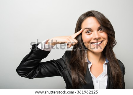 business woman at the head of a finger