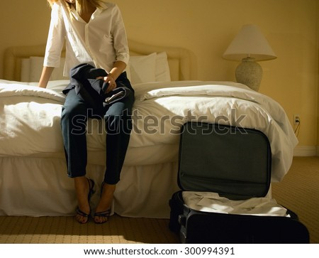 Business woman at the hotel room - stock photo