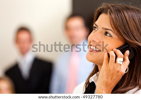 Business woman at the office talking on the phone