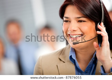 Business woman at the office wearing a headset - stock photo