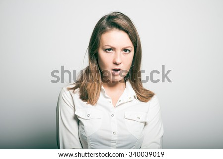 Business woman at work annoyed. studio photo on a gray background - stock photo