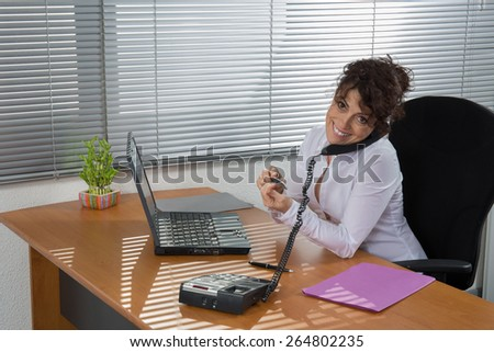 Business woman at work. Confident business woman - stock photo