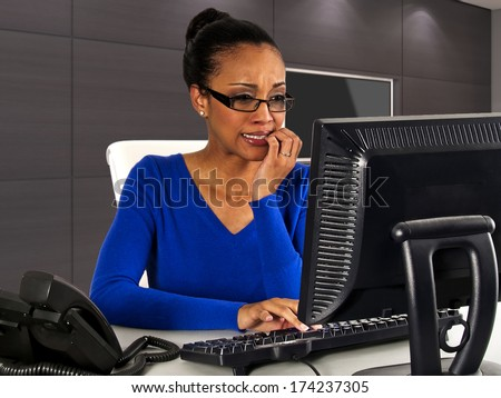 business woman at work in the office with computer - stock photo