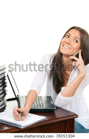 Business woman at work place table with stacks of real books on it and modern laptop, pen and textbook talking on the phone on a white background. - stock photo