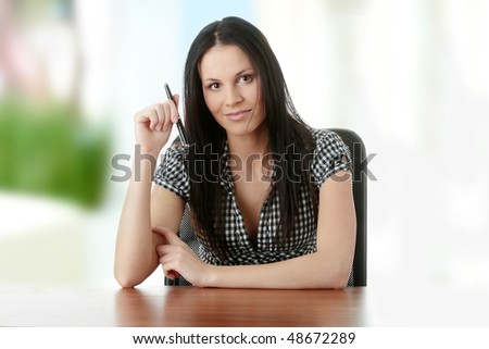 Business woman behind a desk - stock photo