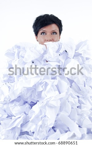 business woman behind a pile of crumpled paper