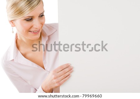 Business woman behind blank banner looking down - stock photo