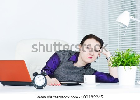 Business woman boring at work - stock photo