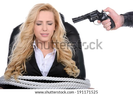 Business woman bound to a chair with rope and aim it to the head with a gun isolated on a white background - stock photo