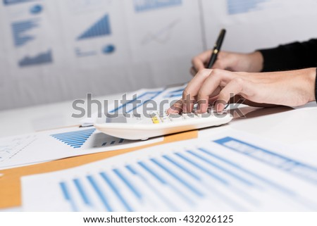 Business woman calculate financial earning summary reports for start-up the online business monthly report. - stock photo