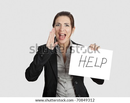 "Business woman calling for help holding a cardboard with the text message ""Help"""