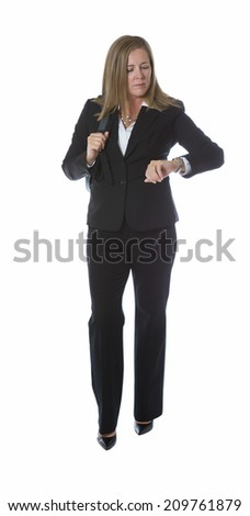 Business woman checking her watch for time, with laptop carry case on her shoulder, while isolated on white  - stock photo