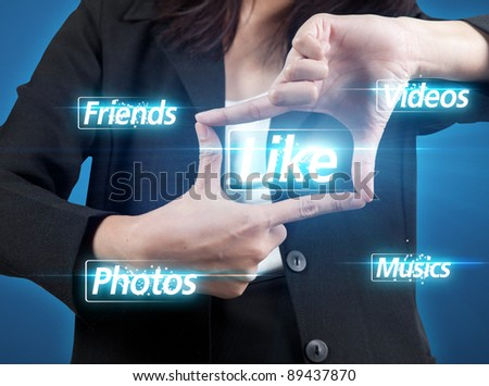 business woman chooses like button - stock photo