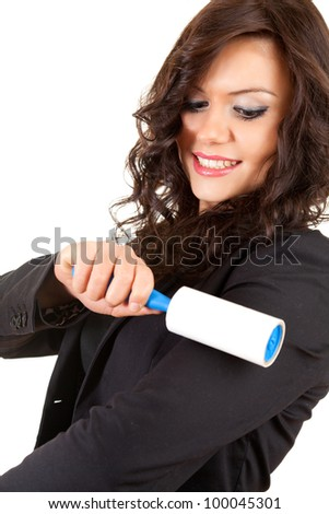 business woman cleaning dust with lint roller, white background