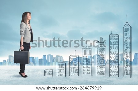 Business woman climbing up on hand drawn buildings in city concept - stock photo
