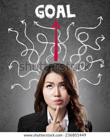 business woman concentration finding the way to reach goal - stock photo