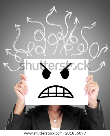 business woman cover her face with paper with stressed expression emoticon on it - stock photo