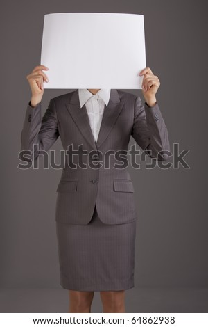business woman covering her face with white paper