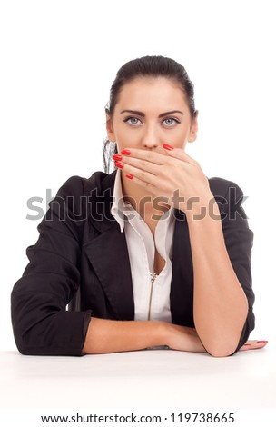 Business woman covering her mouth - stock photo