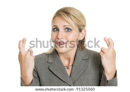 Business woman crossing fingers isolated on white