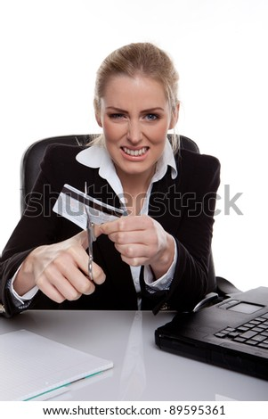 business woman cutting credit card - stock photo