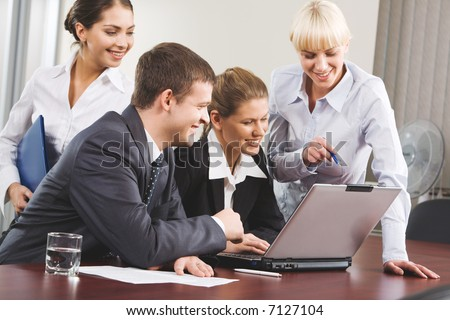 Business woman demonstrating correct way of analysis to three co-workers