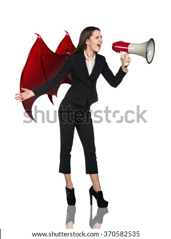 Business woman devil screams to megaphone