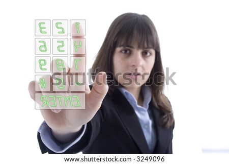 Business woman dialing numbers in a touchscreen isolated on white - stock photo