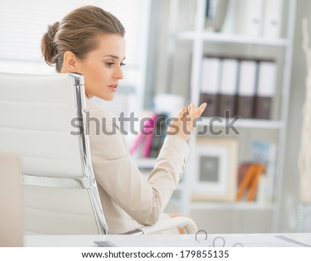Business woman discussing in office - stock photo