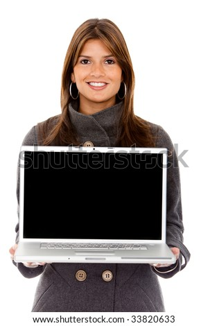 Business woman displaying a laptop isolated over white