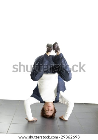 Business woman doing a headstand - stock photo