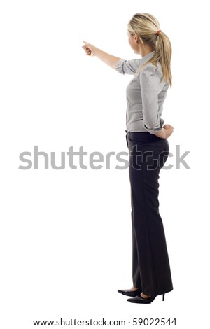 Business woman doing a presentation, she's pointing at something isolated over background - stock photo